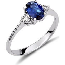 Δαχτυλίδι από λευκό χρυσό 18 καρατίων με μπλε ζαφείρι στο κέντρο και  διαμάντια στο πλάι. 21d8b22ed46