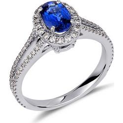 Δαχτυλίδι από λευκό χρυσό 18 καρατίων με μπλε ζαφείρι στο κέντρο και  διαμάντια περιμετρικά και στην 8970f6dfb29